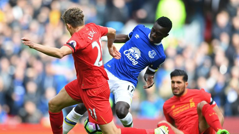 LIVERPOOL, ENGLAND - APRIL 01: Lucas Leiva of Liverpool (L) and Idrissa Gueye of Everton (R) battle for possession during the Premier League match between