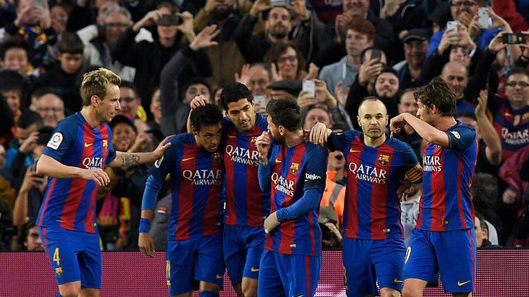 Luis Suarez (3L) celebrates scoring Barcelona's first goal with team-mates during the La Liga match with Sevilla