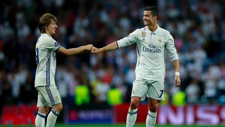 MADRID, SPAIN - APRIL 18: Cristiano Ronaldo (R) of Real Madrid CF clashes knuckles with his teammate Luka Modric (L) after the UEFA Champions League Quarte