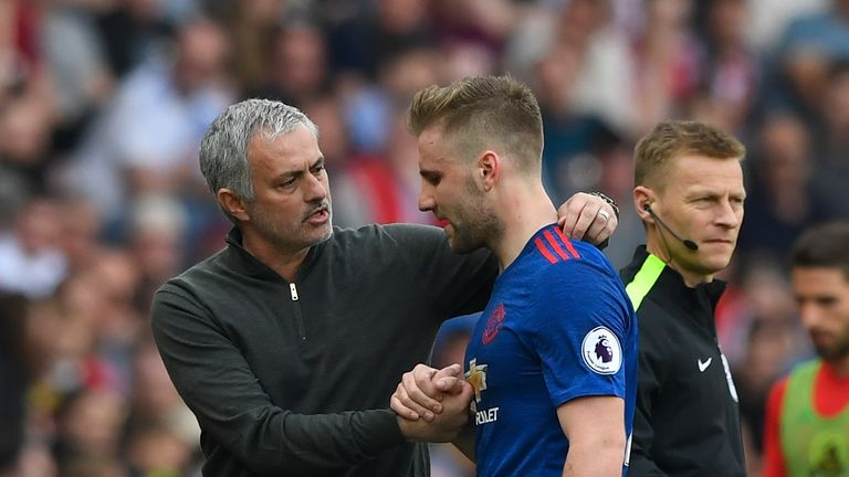 Luke Shaw is greeted by Jose Mourinho after being substituted
