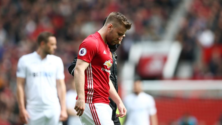 MANCHESTER, ENGLAND - APRIL 30: Luke Shaw of Manchester United looks dejected as he is forced off with a injury during the Premier League match between Man