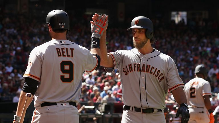 Madison Bumgarner (right) hit two home runs in a losing cause for San Francisco