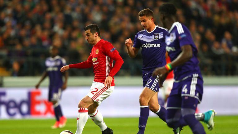 Henrikh Mkhitaryan runs at the Anderlecht defence