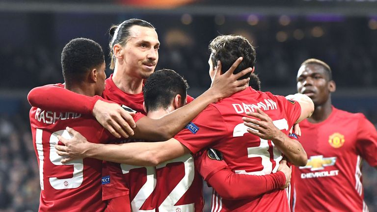 Manchester United's Henrikh Mkhitaryan (3L) celebrates with team-mates after scoring