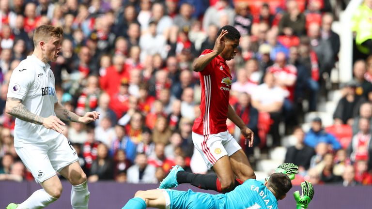 MANCHESTER, ENGLAND - APRIL 30:  Marcus Rashford of Manchester United is fouled by Lukasz Fabianski of Swansea City and a penalty is awarded to Manchester