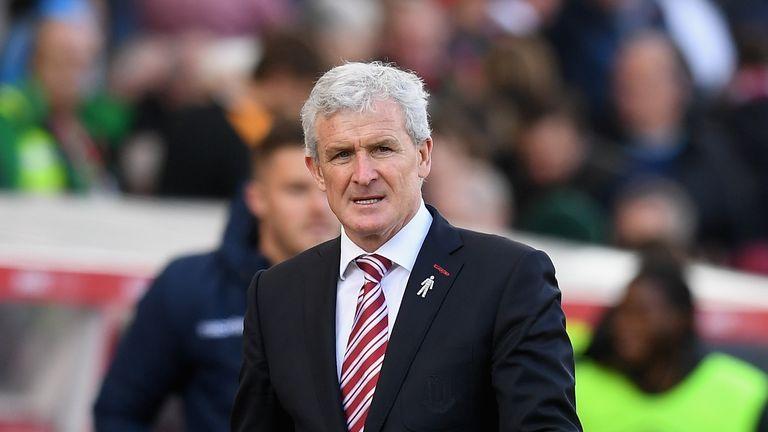 Mark Hughes hopes Stoke can 'upset' Arsenal on Saturday