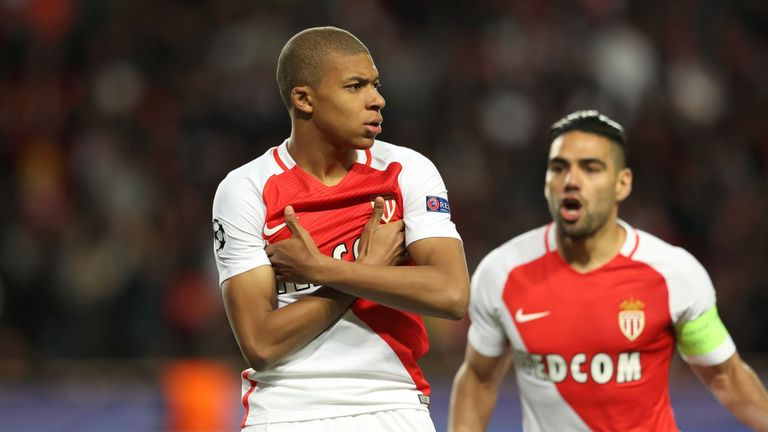 Monaco's French forward Kylian Mbappe Lottin  (L) celebrates after scoring a goal during the UEFA Champions League 2nd leg quarter-final football match AS