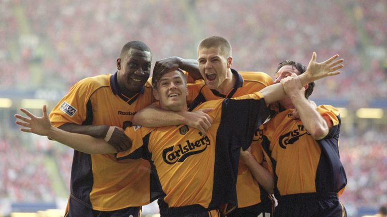 Michael Owen (centre left) scored twice to secure the 2001 FA Cup final against Arsenal
