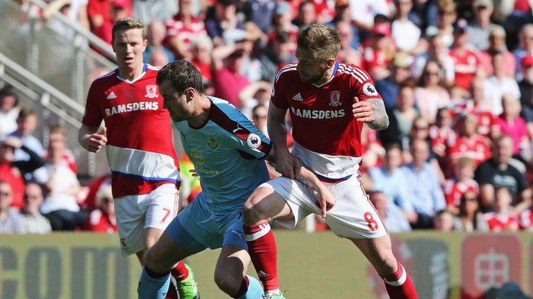 MIDDLESBROUGH, ENGLAND - APRIL 08: Ashley Barnes of Burnley and Adam Clayton of Middlesbrough battle for possession during the Premier League match between