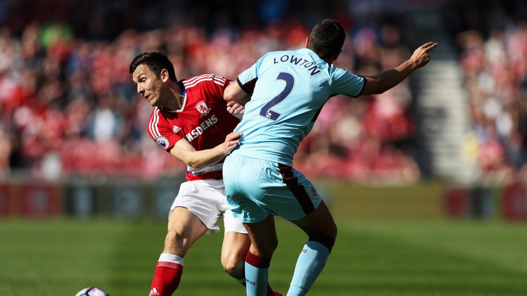MIDDLESBROUGH, ENGLAND - APRIL 08: Stewart Downing of Middlesbrough (L) and Matthew Lowton of Burnley (R) battle for possession during the Premier League m