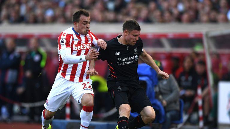 Xherdan Shaqiri battles with James Milner