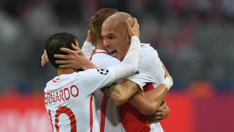 Monaco's players celebrate following Sven Bender's own goal