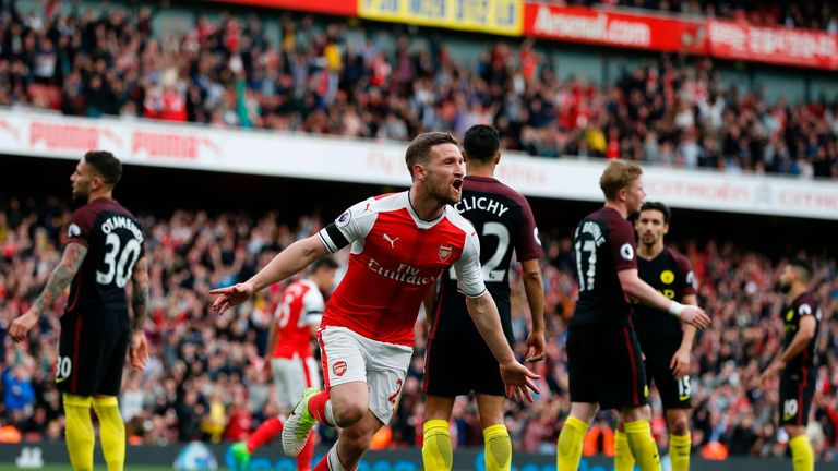 Arsenal's German defender Shkodran Mustafi celebrates after scoring their second goal during the English Premier League football match between Arsenal and