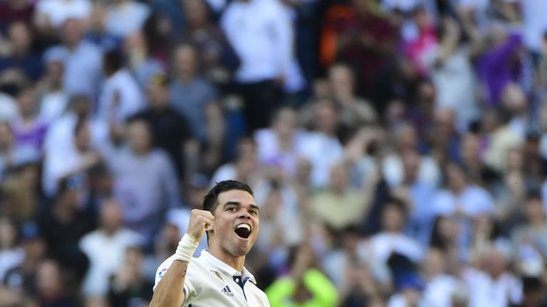 Real Madrid's Portuguese defender Pepe celebrates scoring a goal during the Spanish league football match Real Madrid CF vs Club Atletico de Madrid at the