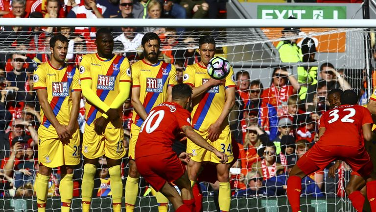Liverpool's Brazilian midfielder Philippe Coutinho (C) opened the scoring with a free-kick