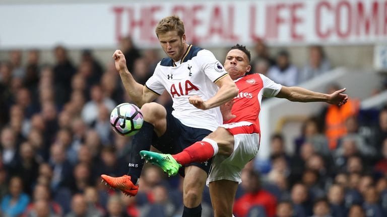 Eric Dier of Tottenham Hotspur and Kieran Gibbs of Arsenal battle for possession during the Premier League match