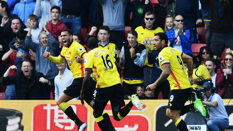 Etienne Capoue is pursued by team-mates while celebrating his goal against Swansea