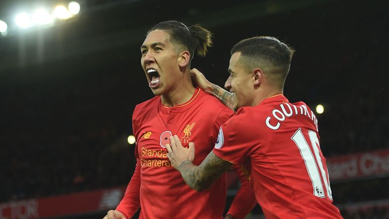 Liverpool's Roberto Firmino (left) celebrates a goal with Philippe Coutinho