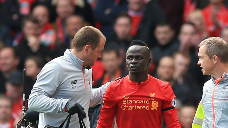 Liverpool's Sadio Mane leaves the pitch after picking up an injury during the Merseyside derby
