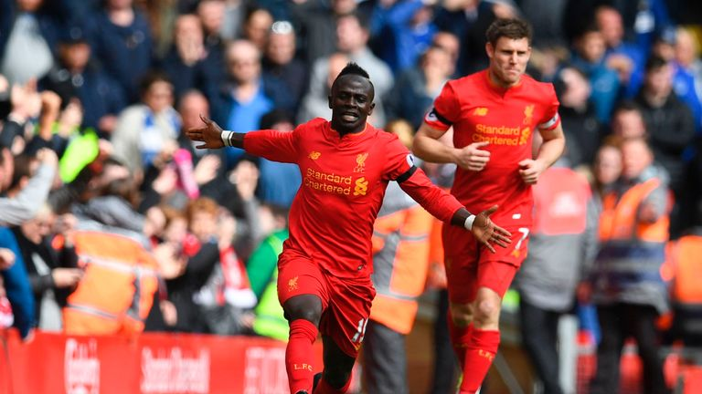 Liverpool's Senegalese midfielder Sadio Mane celebrates after scoring the opening goal of the English Premier League football match between Liverpool and E