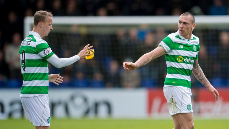 Celtic's Scott Brown hand the captain's armband to teammate Leigh Griffiths