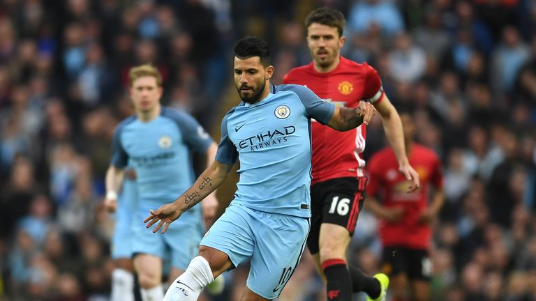 Manchester's City Sergio Aguero is closed down by Michael Carrick