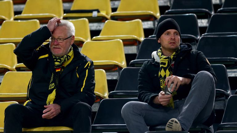 Dortmund fans show their concern as news reaches them of the explosions