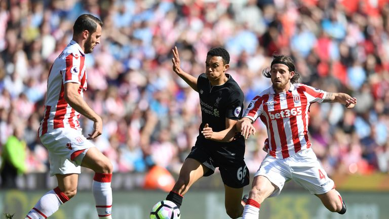 Trent Alexander-Arnold looks to move forward with the ball