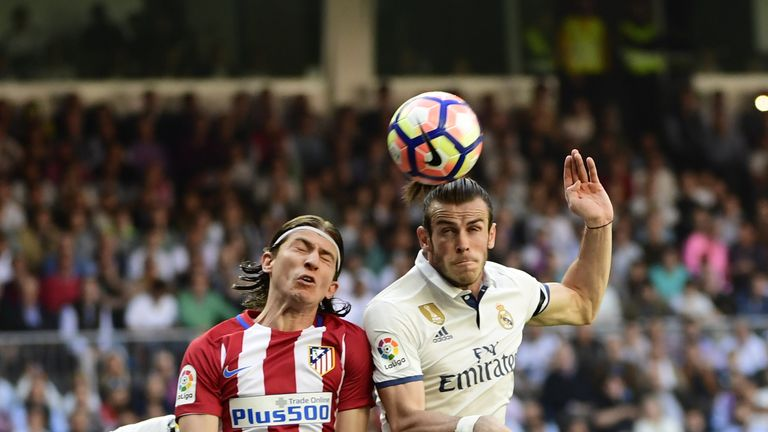 Atletico Madrid's Brazilian defender Filipe Luis (L) heads a ball with Real Madrid's Welsh forward Gareth Bale  during the Spanish league football match Re