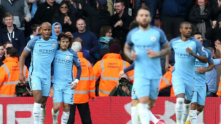 Manchester City's Vincent Kompany (left) celebrates scoring his side's first goal of the game during the Premier League match at Southampton
