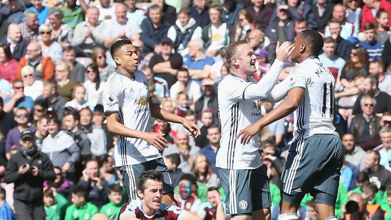Wayne Rooney celebrates Anthony Martial's opener for Manchester United against Burnley