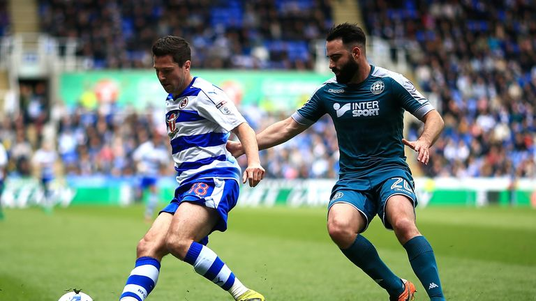 Yaan Kermorgant of Reading holds off pressure from Craig Morgan of Wigan during the Sky Bet Championship match between Reading and Wigan