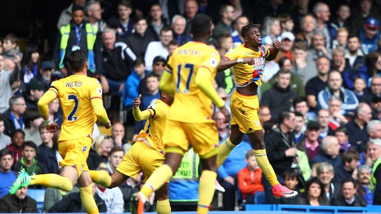 Wilfried Zaha of Crystal Palace (R) celebrates scoring his side's first goal during the Premier League match v Chelsea