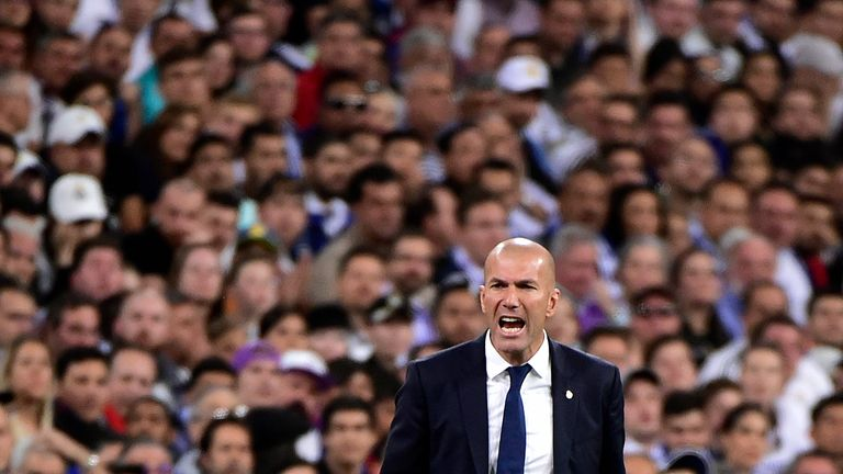 Real Madrid's French coach Zinedine Zidane shouts on the sideline during the Spanish league Clasico football match Real Madrid CF vs FC Barcelona at the Sa
