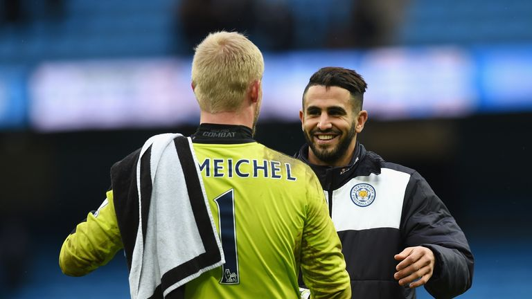 Leicester City players Kasper Schmeichel and Riyad Mahrez