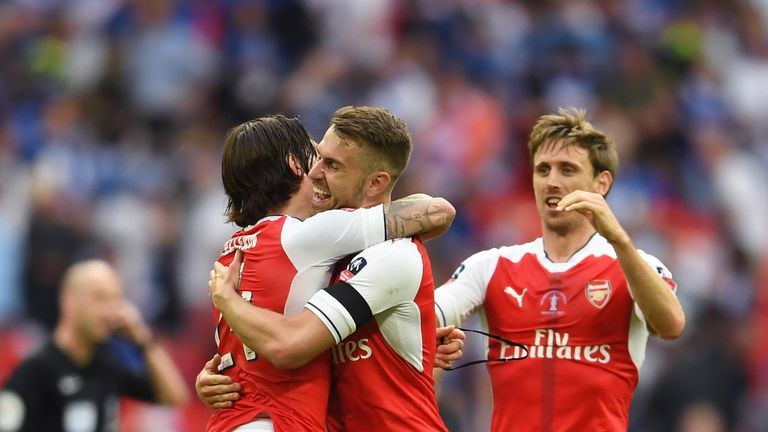 Hector Bellerin of Arsenal, Aaron Ramsey of Arsenal and Nacho Monreal of Arsenal celebrate after The Emirates FA Cup Final win v Chelsea