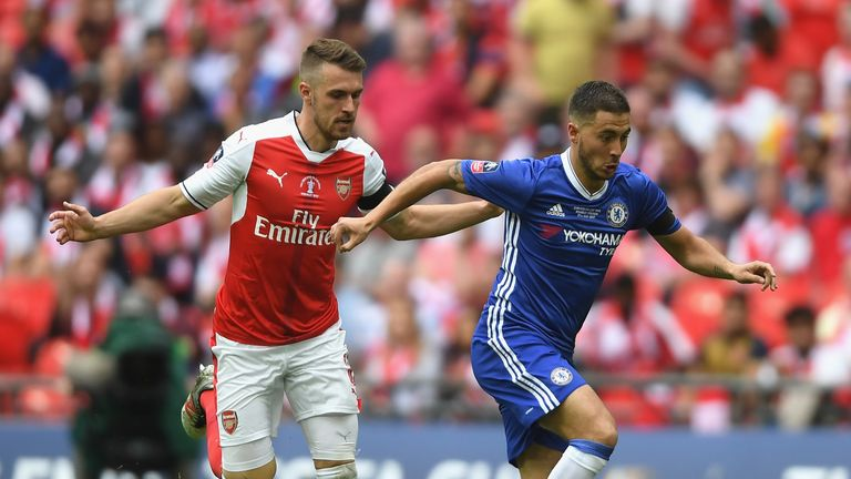 Eden Hazard of Chelsea is chased down by Aaron Ramsey of Arsenal during The Emirates FA Cup Final between Arsenal and Chelsea
