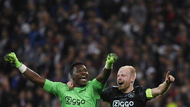 Ajax' Dutch midfielder Davy Klaassen (R) and Ajax's English goalkeeper Andre Onana (L) celebrates their victory in the Europa League semi-final football ma