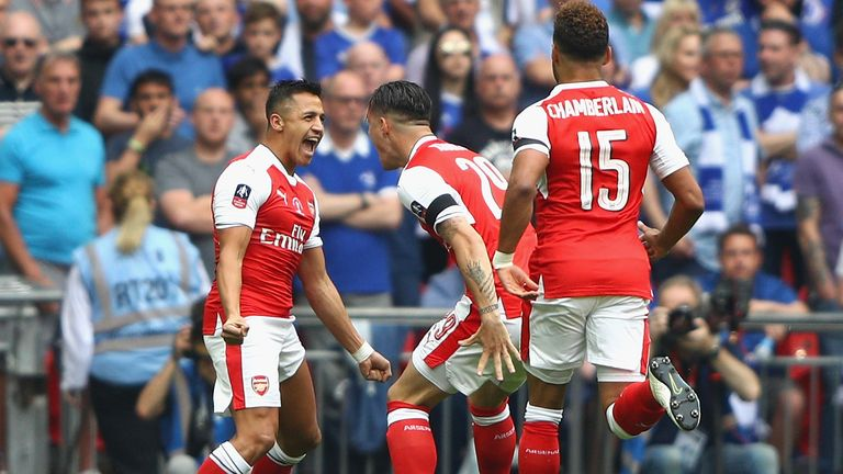 Alexis Sanchez of Arsenal celebrates scoring his side's first goal with his Arsenal team-mates during the Emirates FA Cup Final v Chelsea at Wembley