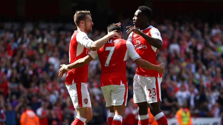 Alexis Sanchez (C) celebrates scoring with Aaron Ramsey (L) and Danny Welbeck (R)