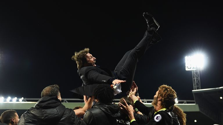 Antonio Conte is given the celebration bumps by his Chelsea players