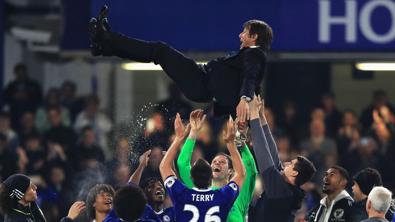 LONDON, ENGLAND - MAY 15:  Antonio Conte, Manager of Chelsea is thrown in the air by his team as part of celebrations after the Premier League match betwee