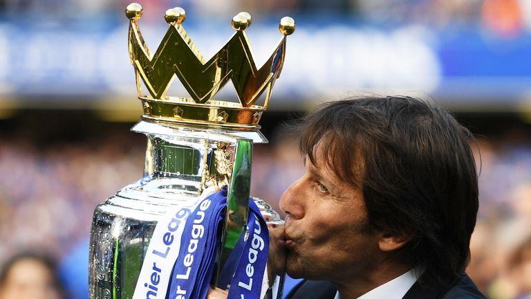 Antonio Conte kisses the Premier League trophy after the 5-1 win over Sunderland