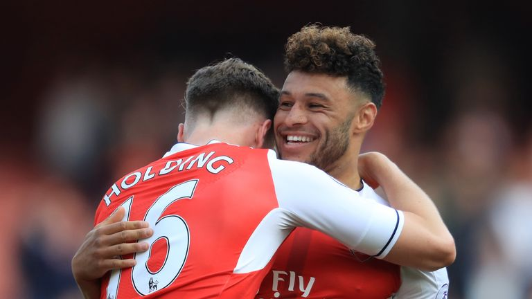 Rob Holding and Alex Oxlade-Chamberlain celebrate Arsenal's win over Manchester United