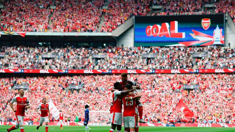 Arsenal's Alexis Sanchez celebrates with team-mates after scoring the opening goal of the FA Cup final v Chelsea