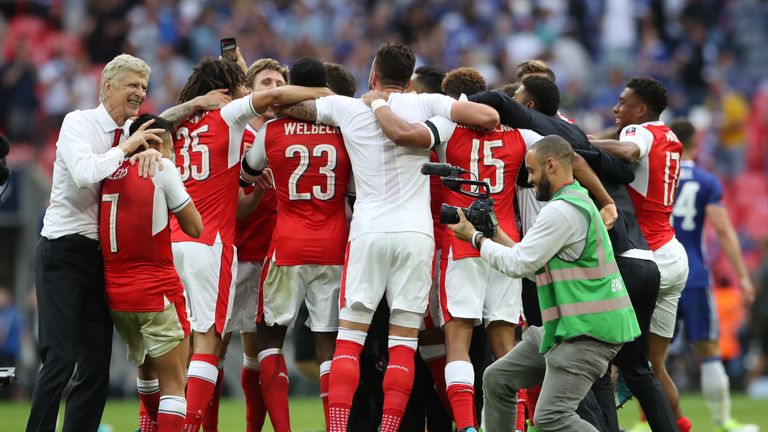 Arsenal manager Arsene Wenger celebrates with Arsenal's Alexis Sanchez after the final whistle v Chelsea during the Emirates FA Cup Final at Wembley