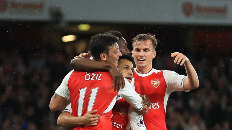 Alexis Sanchez of Arsenal celebrates scoring his sides first goal with his Arsenal team mates during the Premier League match against Sunderland