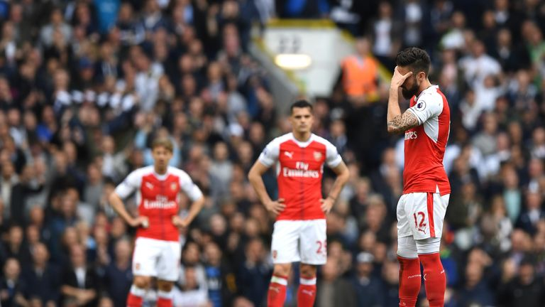 Arsenal players show the strain during the defeat to Tottenham