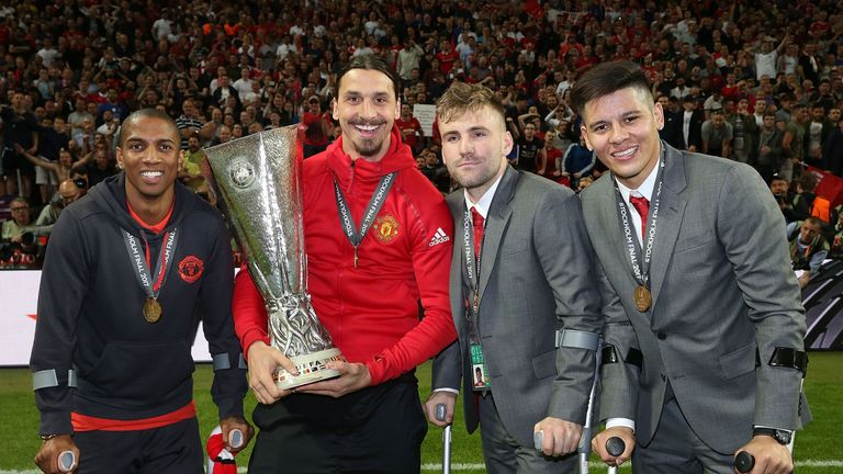 Ashley Young, Ibrahimovic, Luke Shaw and Marcos Rojo celebrate with the Europa League trophy