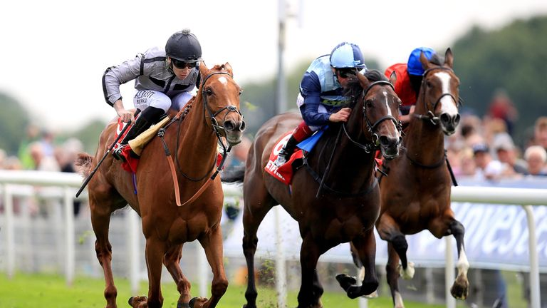 Blond Me ridden by jockey Oisin Murphy (left) on the way to winning the Betfred Middleton Stakes
